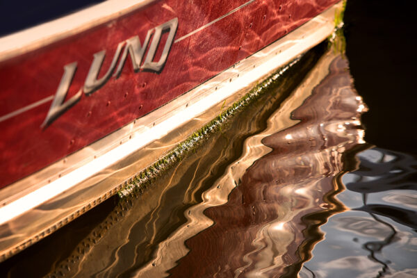 water lapping against the side of a boat docked in Essex Marina